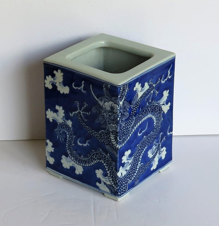 This is a high quality Chinese export porcelain brush pot, finely hand painted in blue and white depicting two imperial 5 toed dragons among clouds.  These brush pots are often used as jardinières.  The pot has a well hand potted shape which is