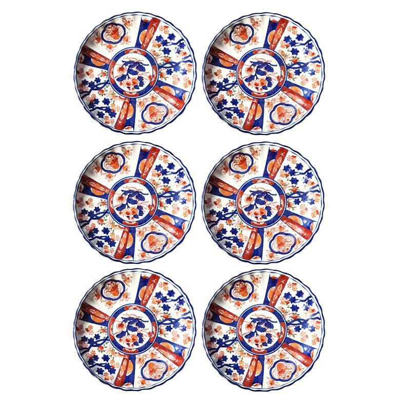 Set of six Chinese export orange and blue imari porcelain plates. (Thought to be from the Kangxi period.)   This set of plates feature decorative hand-painted designs in blue, orange and red on a white background. The sides are scalloped and painted