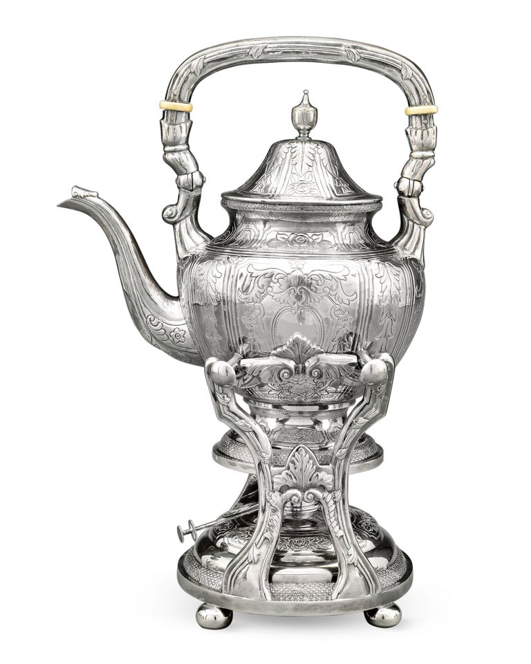 This stunning and complete seven-piece Chinese export silver tea and coffee service was crafted by Yu Chang of Shanghai and Hong Kong, a firm renowned for its unique and high-quality creations. Comprising a hot water kettle and stand, tea pot,