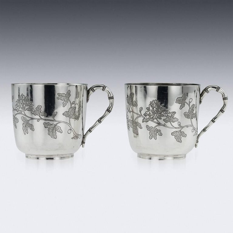 Antique 19th century Chinese solid silver pair of tea cups and saucers, the sides are engraved with chrysanthemum flowers and bamboo. The tea cups are of good traditional size and features stunning workmenship. Hallmarked with Chinese characters to
