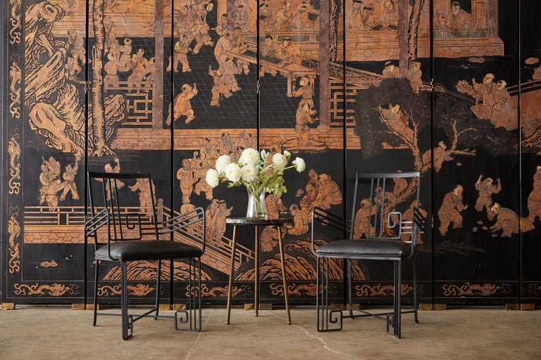 Stunning monumental Chinese export twelve-panel gilt Coromandel screen. Featuring an intricately relief carved black lacquered background depicting one hundred boys in a courtyard playing at leisurely activities. The beautifully incised panels are