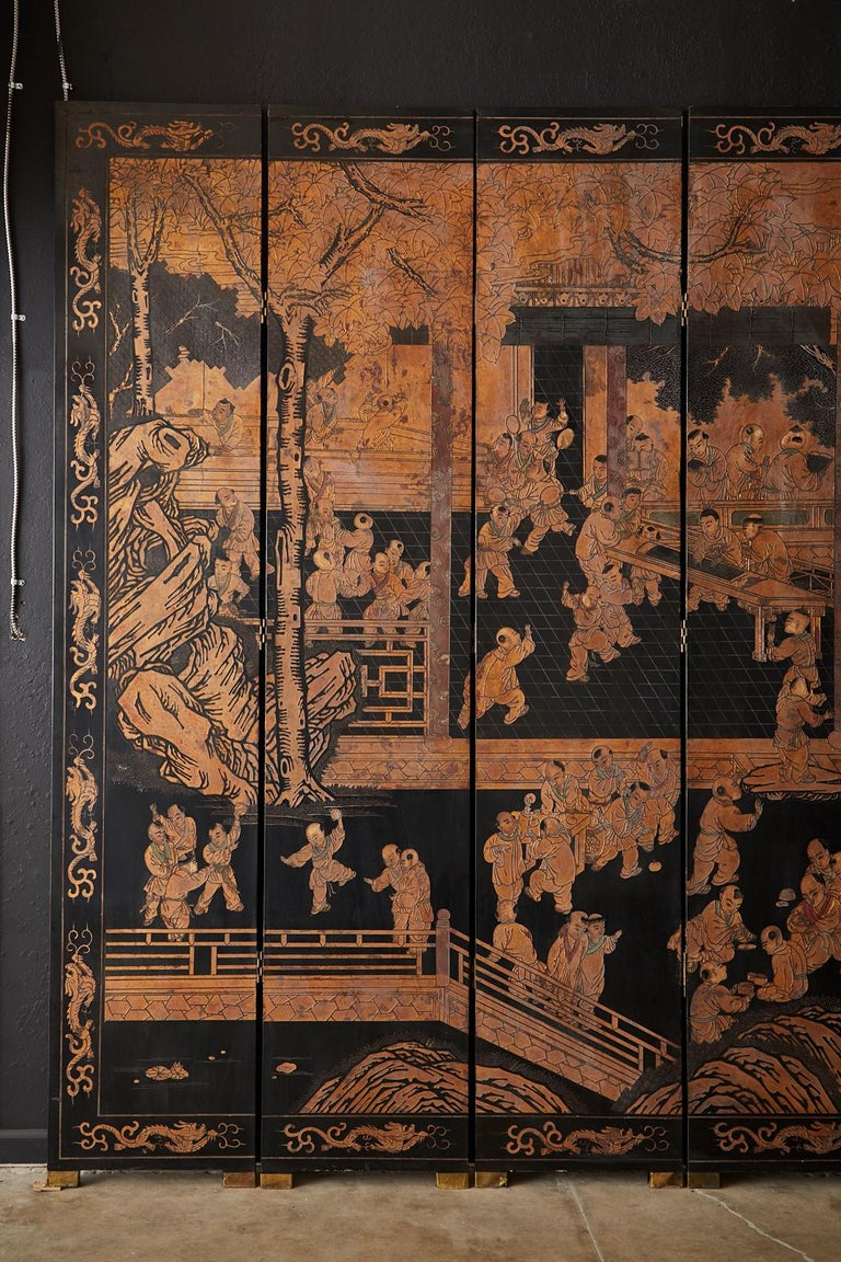 Hand-Crafted Chinese Export Twelve-Panel Lacquered Parcel-Gilt Coromandel Screen