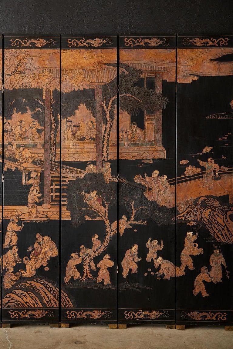 20th Century Chinese Export Twelve-Panel Lacquered Parcel-Gilt Coromandel Screen