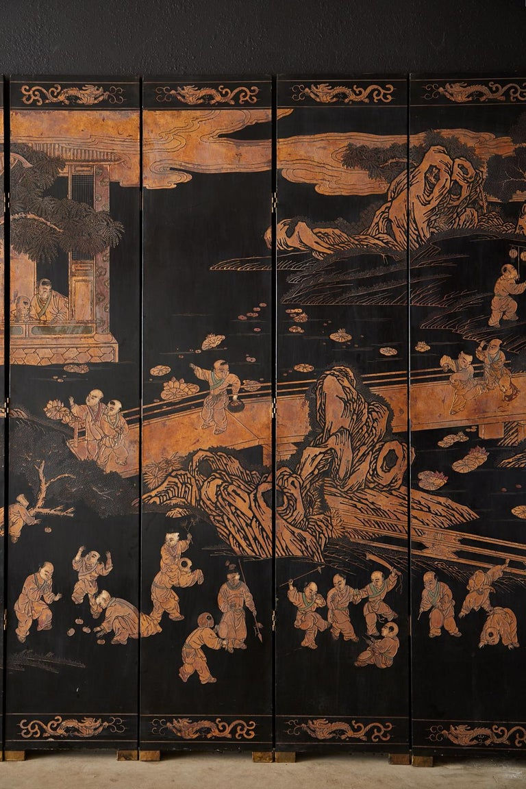 Brass Chinese Export Twelve-Panel Lacquered Parcel-Gilt Coromandel Screen