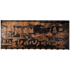 Chinese Export Twelve-Panel Lacquered Parcel-Gilt Coromandel Screen