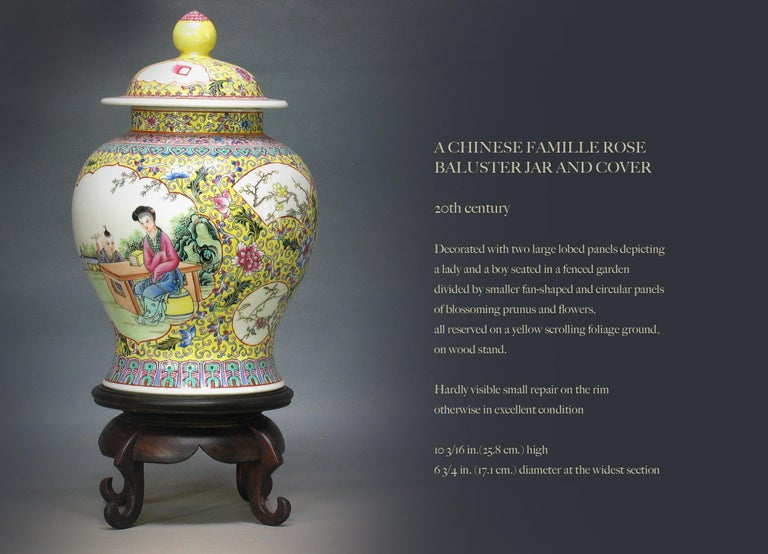 A Chinese famille rose Baluster jar and cover  20th century.  Decorated with two large lobed panels depicting  a lady and a boy seated in a fenced garden  divided by smaller fan-shaped and circular panels  of blossoming prunus and flowers,