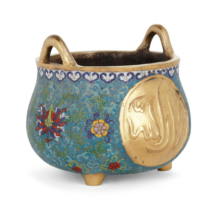 Chinese Floral Islamic style cloisonné enamel and ormolu vase Chinese, early 20th century Dimensions: Height 18cm, diameter 21cm  This beautiful bowl is a superb example of Chinese export ware designed for an Islamic market. The bowl is crafted