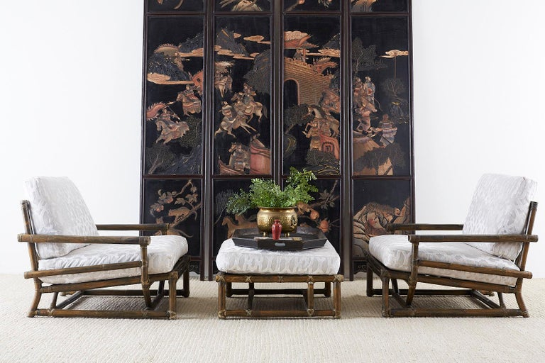 Large Chinese export four panel coromandel screens. Featuring a lacquered decoration on each side. Each panel is 96 inches high with intricately carved scenes of warriors on one side and landscape scenes on the back. The black lacquer has a