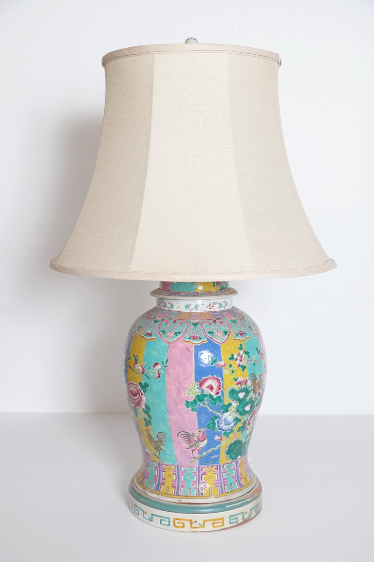 Large Chinese porcelain famille rose ginger jar, drilled as lamp, featuring pastel panels with floral overlay and roosters, custom hand painted base, some losses, chipping and flaking (visible in posted photos), chip to base of ginger jar as well,