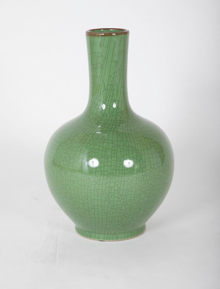 A Chinese vase of impressive size, apple green glaze with wonderful crazed surface, mid 20th century, signature on the bottom.  19.5 inches high 12 wide and deep.