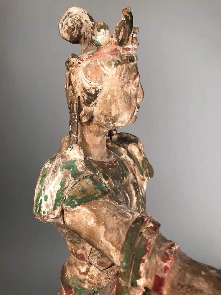 Chinese Guan Yin figure, early Ming dynasty (1368-1644). Painted carved wood with traces of apparently original polychrome decoration. Some minor losses entirely consistent with age.  Nb. Often these early wooden sculptures have been overpainted and