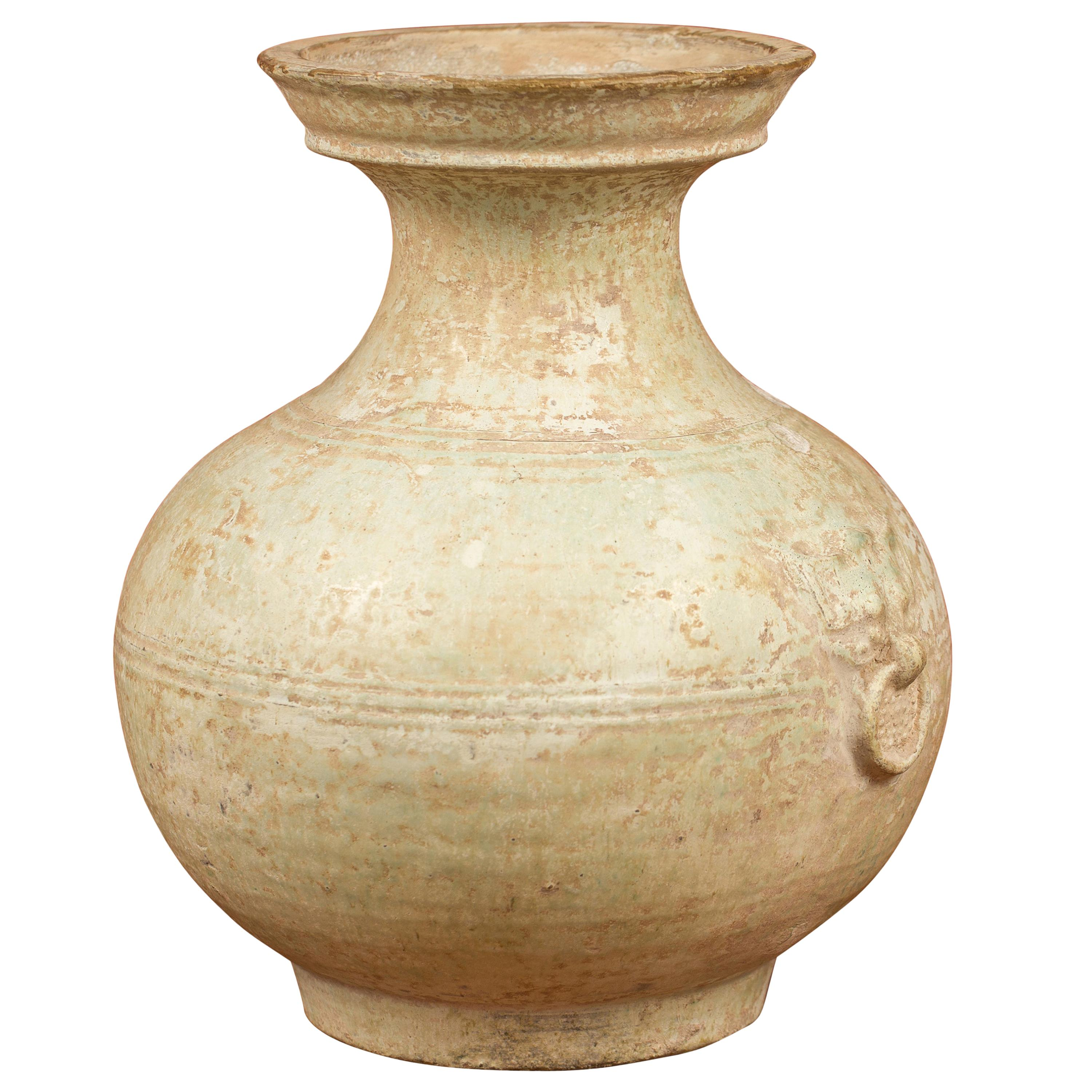 Chinese Han Dynasty Hu Vessel with Light Green Glaze and Decorative Rings