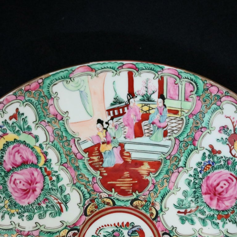 A Chinese Rose Medallion charger offers porcelain construction with hand painted enamel panels of alternating genre and garden scenes, stamped en verso as photographed, 20th century  ***DELIVERY NOTICE – Due to COVID-19 we are employing NO-CONTACT