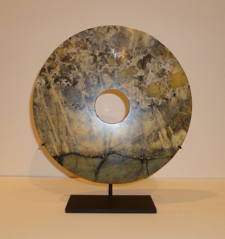 Fine Chinese hard stone disc on black metal stand, beautiful form, color and texture. 10