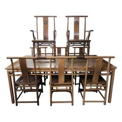 Chinese Hard Wood Dining Table & Eight Matching Chairs all with Stylized Carving