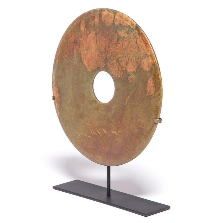 Found in the tombs of ancient Chinese emperors and aristocrats, bi discs such as this have a mysterious and spiritual history, and their function and significance remain unknown. Shaping this hard stone takes considerable skill. An artisan imbues