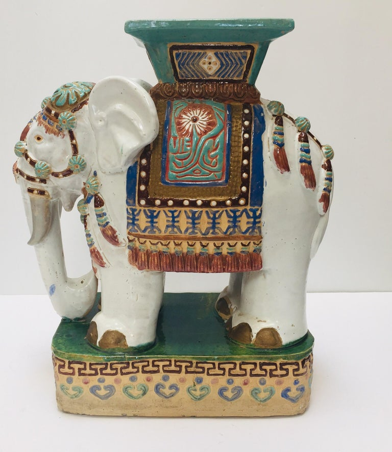 Large vintage midcentury Asian Chinese elephant garden patio stool. Elegant garden seat in the shape of an elephant heavily decorated in oriental finery.  The mammal seat on a raised pedestal and has a square seat at the top, it is hand painted in a