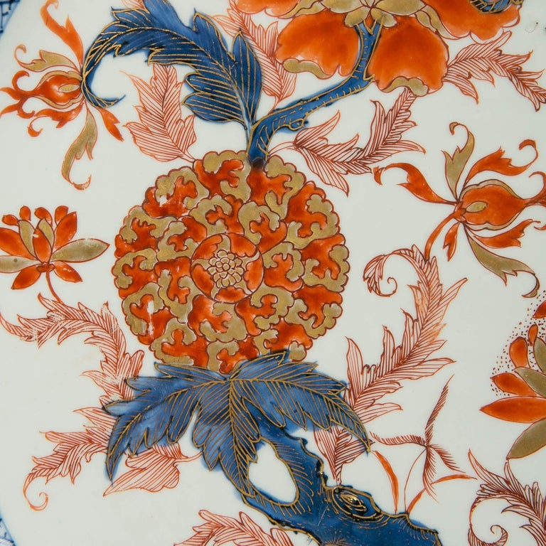 Why we love it: Look at the image! This beautiful Chinese Imari porcelain charger is dated to the Qianlong period of the Qing dynasty, circa 1750. The charger has a vivid palette of orange red, cobalt blue, mahogany and gold. In the central panel,
