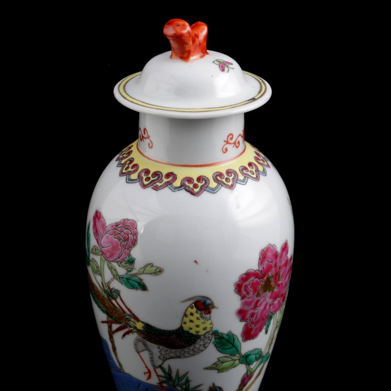 Chinese Imari porcelain lidded vase features hand painted garden scene with pheasants, decorative collar and footer, lid with figural finial, block stamped on base with made in China, 20th century.  ***DELIVERY NOTICE – Due to COVID-19 we are