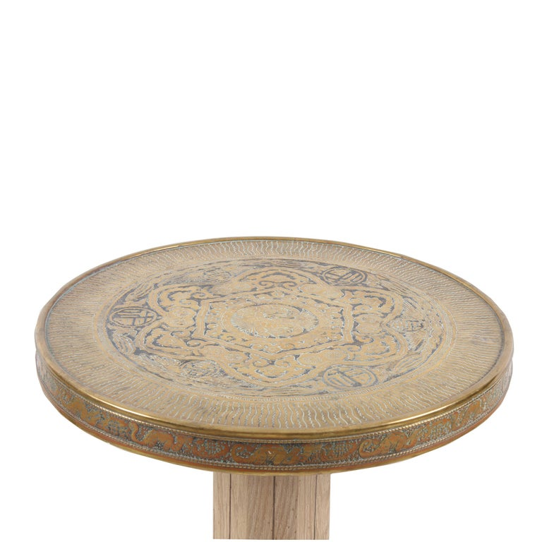 This side table features an incredibly detailed top, using the repusé method (hammered in), with dragons, birds, a sun motif and various characters. Every time you look at it, you find something new!  The base is made from ash, with a geometric