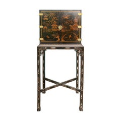 Chinese Lacquered Cabinet on Finely Carved Fretwork Stand, circa 1860-1880