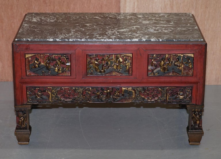 We are delighted to offer for sale this lovely vintage marble topped Chinese tea table constructed with vintage circa 1940 hand carved giltwood panels