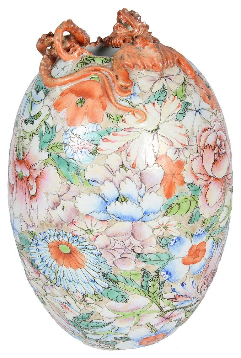 A good quality Chinese Millie Fleur porcelain vase, having a mythical iron red dragon around the top, wonderful exotic floral decoration to the body and a six character mark to the base.