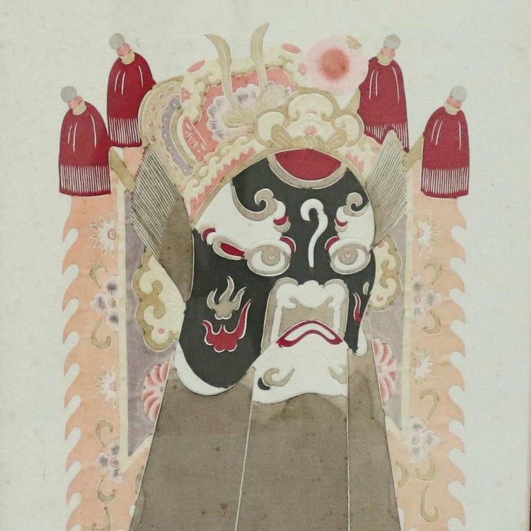 A Chinese framed print offers mixed media depiction of ceremonial deity mask, 20th century  ***DELIVERY NOTICE – Due to COVID-19 we are employing NO-CONTACT PRACTICES in the transfer of purchased items.  Additionally, for those who prefer to delay