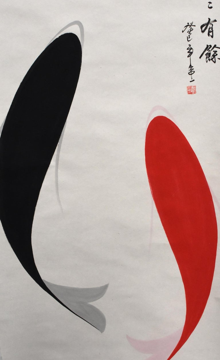 Chinese watercolor scroll painting of a pair of black and red koi fish in modern interpretation. Painted on rice paper, signed by artisit Yi Wei, marked in Chinese calligraphy