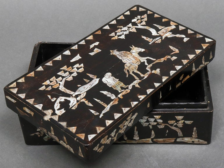Chinese mother of pearl inlaid lacquered rectangular box, depicting in landscape, circa late 19th-early 20th century. Measures: 3.5