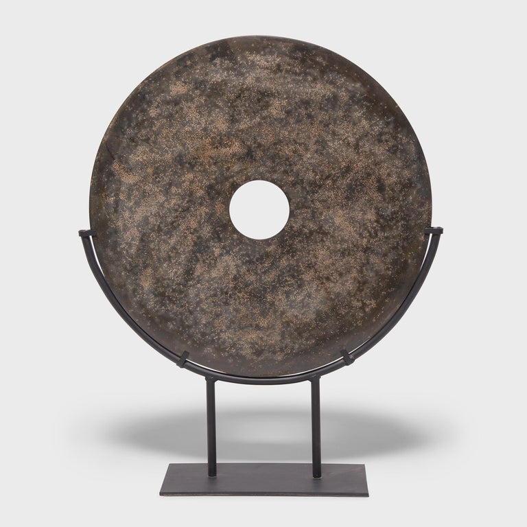 Jades have been cherished for thousands of years for their rich heritage, beauty, and rarity. Found in the tombs of ancient Chinese emperors and aristocrats, jade bi discs such as this have a mysterious and spiritual history, and their function and