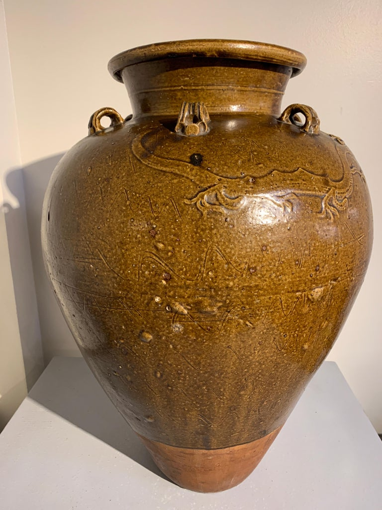 A fine and large Chinese brown ochre glazed stoneware storage jar, commonly known as a Martaban or Martavan jar, Ming dynasty, 15th-16th century.