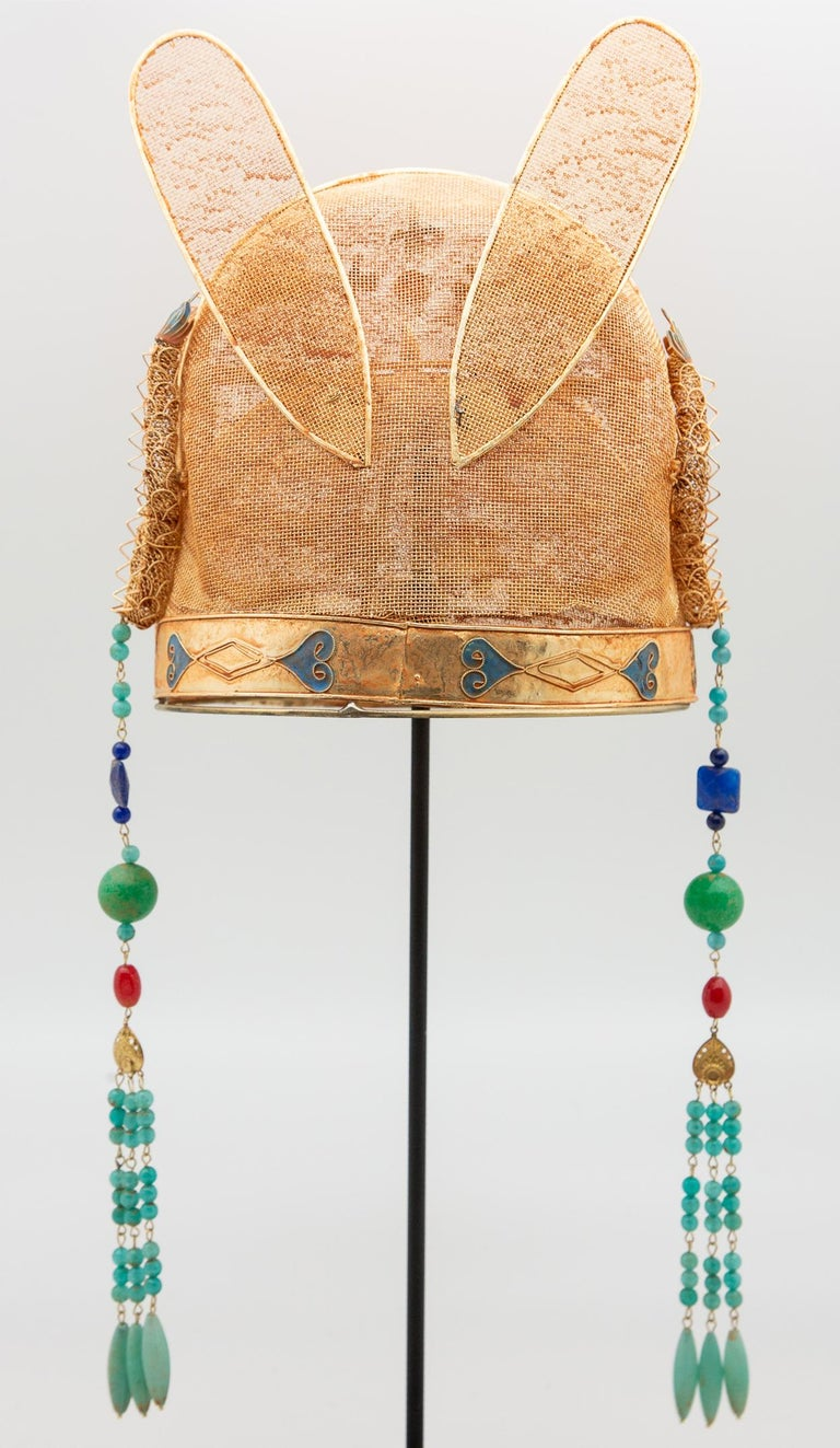 Chinese opera theatre headdress, ears and dragons. Chinese opera theatre headdress with dragons, ears, beaded tassels, and red stones, mid-20th century, mounted on a custom black painted metal base. Measures: 20.5