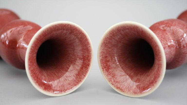 Glazed Chinese Pair of Qianlong Mark Sang De Boeuf Porcelain Gu Vases, 20th Century For Sale