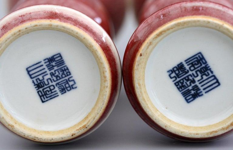 Chinese Pair of Qianlong Mark Sang De Boeuf Porcelain Gu Vases, 20th Century For Sale 1