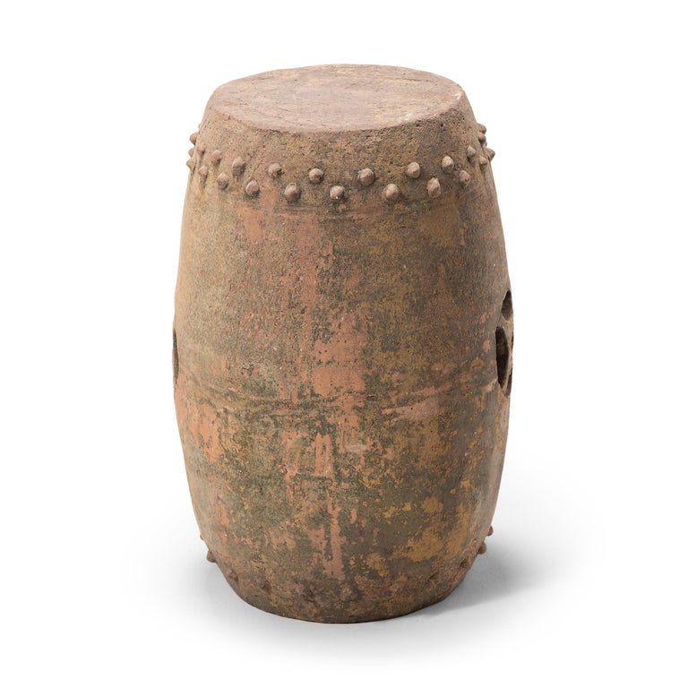 This early 20th century terracotta garden stool was created in Pingyao, an ancient, respected city in China's Shanxi province. With a history dating as far back as c. 800 B.C., Pingyao is widely known for its well-preserved Ming- and Qing-dynasty