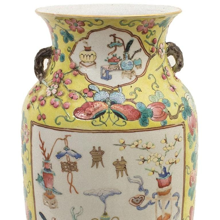 The Chinese polychrome vase is a superb ceramic vase, realized in the early 20th century.   Yellow ground with polychrome fruits, butterflies and flowers, two large reserves with good omen objects. In very good condition.  Provenance: private
