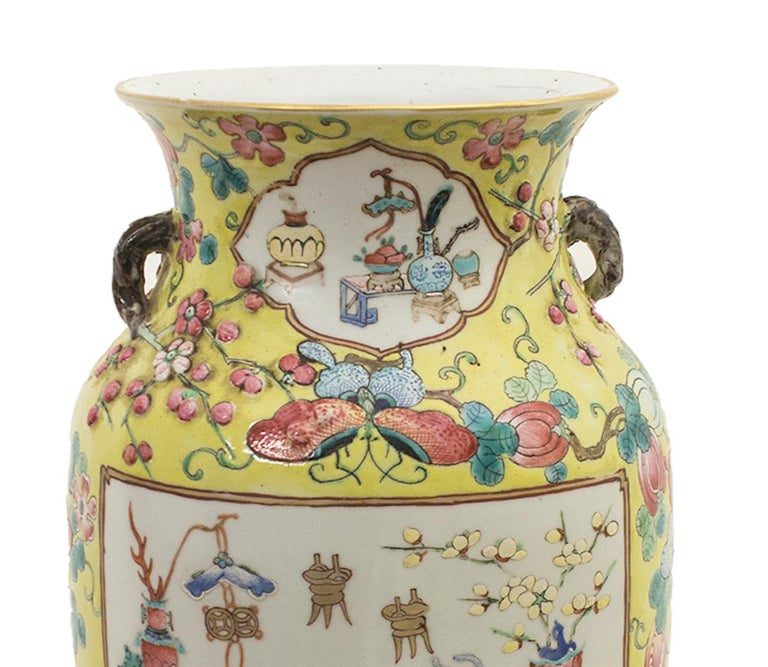 The Chinese polychrome vase is a superb ceramic vase, realized in the early 20th century.   Yellow ground with polychrome fruits, butterflies and flowers, two large reserves with good omen objects.  In very good condition.   Provenance: