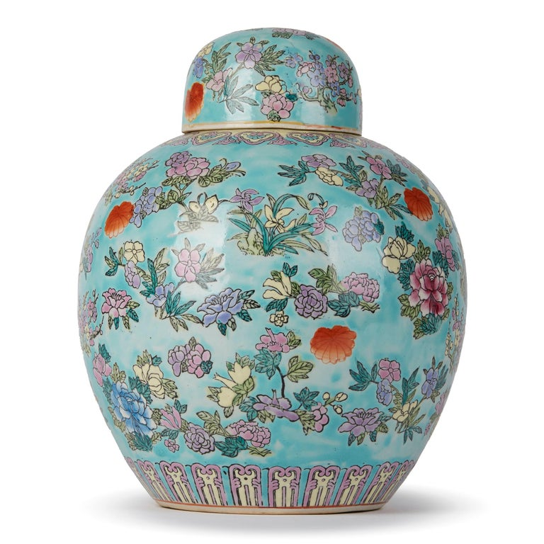 A fine and decorative Chinese bulbous porcelain ginger jar and cover decorated in a famille rose floral design on a light turquoise ground with decorative borders around the top and foot rim and with a domed cover in similar decoration. The jar has