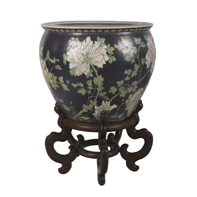 This porcelain Chinese flower pattern fish bowl was created in Hong Kong, China around 1960. Fish bowl is round in shape, the porcelain bowl features beautiful hand painted floral design throughout the exterior. The interior is painted on the inside