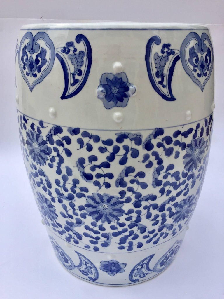 Chinese porcelain garden seats or end tables in blue and white floral motif. Blue and white Chinese ceramic garden stool with hand-painted striking floral chinoiserie floral art work. Great to use indoor or outdoor as a stool or stand for