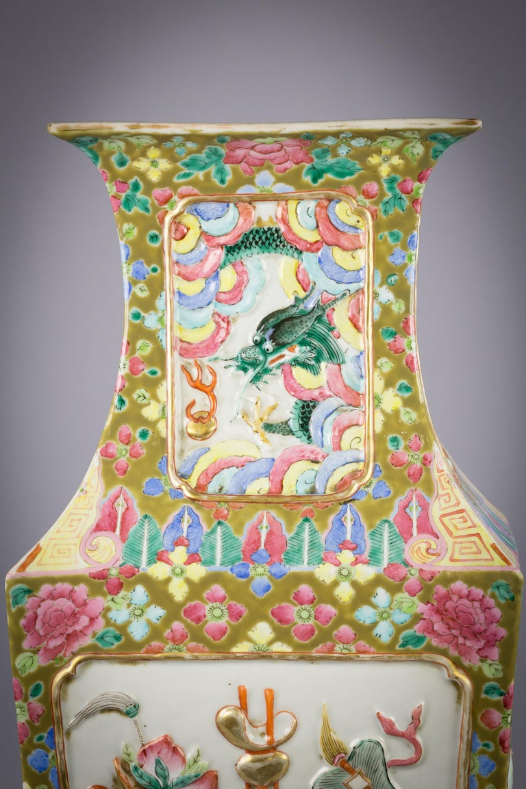 Chinese porcelain mandarin pallet vase, circa 1860  With molded emblems.
