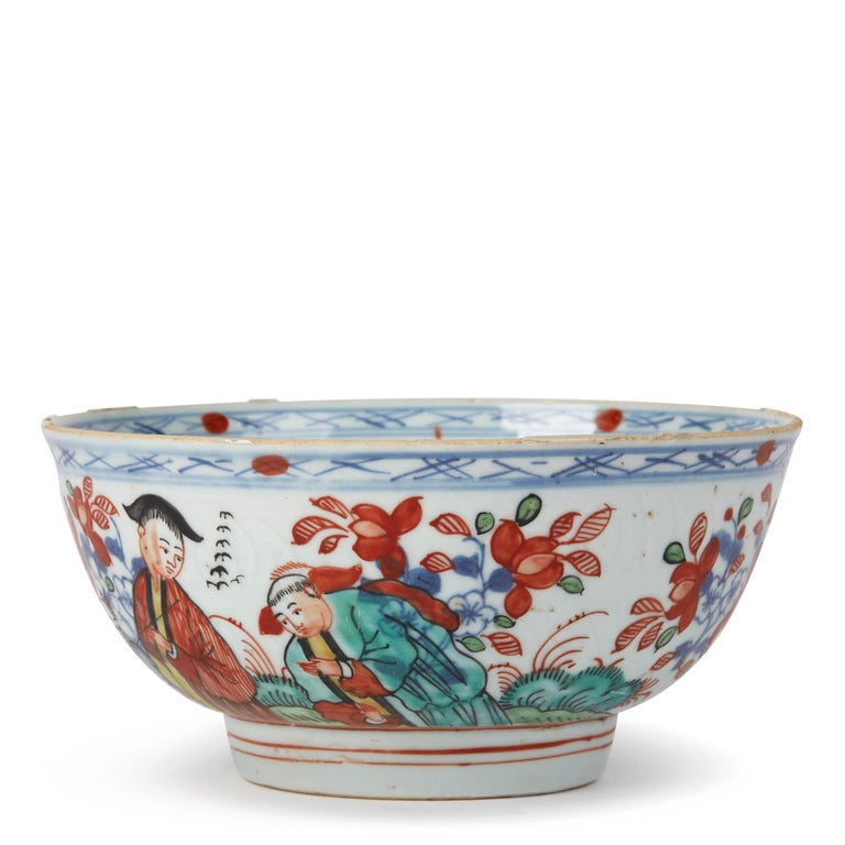A rare and unusual antique Chinese Qianlong, or earlier, porcelain bowl, probably Dutch decorated with a figure in a red gown with two attendants surrounded by underglaze blue and enameled floral sprigs against an anhua ground, the inner bowl with
