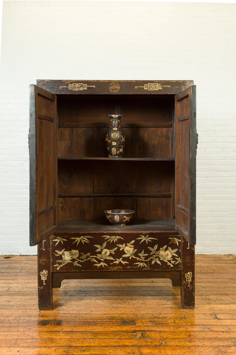 20th Century Chinese Qing Brown Lacquered Two-Door Cabinet with Hand Painted Chinoiserie For Sale