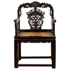 Chinese Qing Dynasty 19th Century Black Lacquered Hand Carved Chair with Rattan