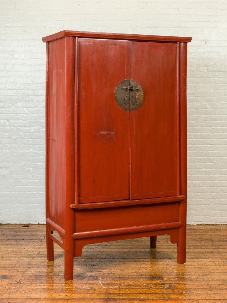 Chinese Qing Dynasty 19th Century Red Lacquered Armoire with Bronze Medallion In Good Condition For Sale In Yonkers, NY