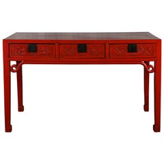 Chinese Qing Dynasty 19th Century Red Lacquered Desk with Floral Carved Drawers