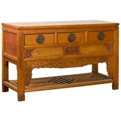 Chinese Qing Dynasty 19th Century Waisted Sideboard with Carved Floral Motifs