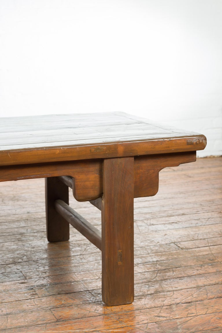 Wood Chinese Qing Dynasty 19th Century Wide Coffee Table with Carved Spandrels For Sale