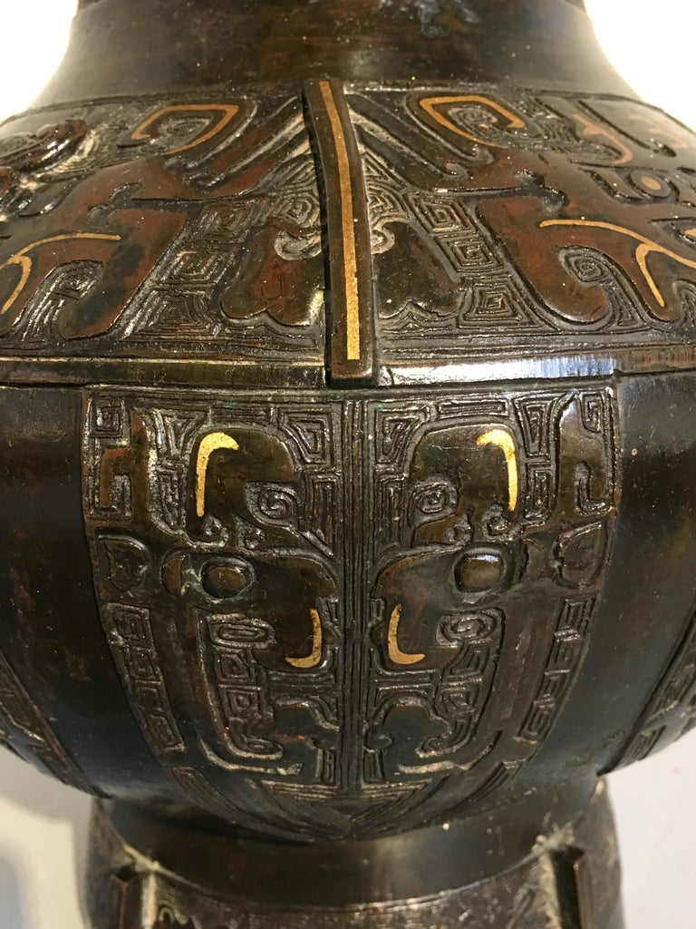 Chinese Qing Dynasty Archaistic Bronze Parcel-Gilt Hu Vase, Mid-18th Century 10